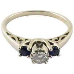 18 Karat White Gold Diamond and Genuine Sapphire Ring