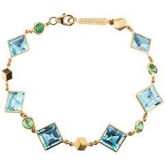18 Karat Yellow Gold Florentine Bracelet with Blue Topaz and Tsavorite Garnets