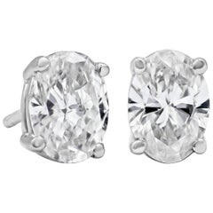 0.95 Carat Total Oval Cut Diamond Stud Earrings