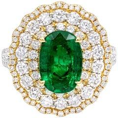 2.29 Carat Oval Cut Emerald & Diamond Triple Halo 14 Karat White Gold Ring