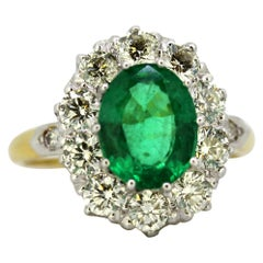 Vintage 18 Karat Gold and Platinum Ladies Ring with Emerald and Diamonds