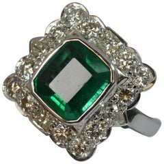 Huge Emerald and Diamond 14 Carat White Gold Cluster Cocktail Ring
