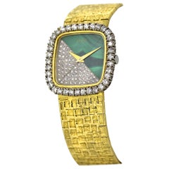 Piaget, Ladies 18 Karat Gold, Diamond and Malachite Manual Wind Bracelet Watch