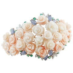 White Diamonds Emeralds Blue Sapphires Rose Coral White and Rose Gold Bracelet