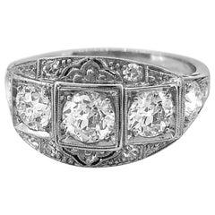 Art Deco 3-Stone Antique Engagement Ring 1.45 Carat T.W. Diamond Platinum