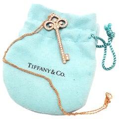 Tiffany & Co. 18 Karat Rose Gold Diamond Fleur-de-Lis Diamond Key Necklace