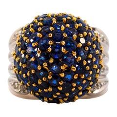 12.00 Carat Blue Sapphire 0.50 Carat White Diamond Yellow Gold Cocktail Ring