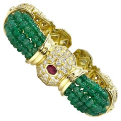 18 Karat Gold Cuff Bracelet with Emeralds, Diamonds and Rubies