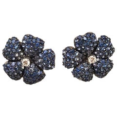 18 Karat Blue Sapphire and White Diamond Flower Pierced Earrings