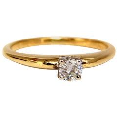 .25 Carat Petite Solitaire Round Cut Diamond Ring 14 Karat H/Vs2