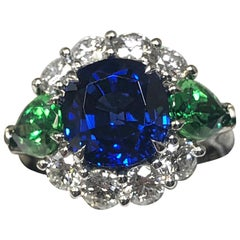Vivid Blue Sapphire 4.45 Carat with AGL Cert. Tsavorite & Diamond Cocktail Ring