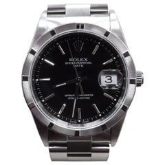 Rolex Date 15210 Stainless Steel Engine Turned Bezel Black Dial Box and Papers