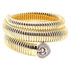 Coiled Snake 14 Karat Yellow Gold Bracelet with Diamonds