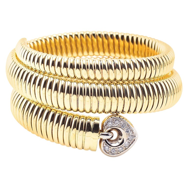 Coiled Snake 14 Karat Yellow Gold Bracelet with Diamonds For Sale
