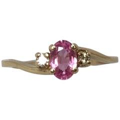 Vivid 0.52 Carat Pink Sapphire and Diamond Three-Stone 14 Karat Yellow Gold Ring