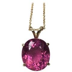Large Vivid Pink Tourmaline 6.10 Carat Fancy Oval Cut 14 Karat Gold Pendant