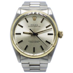 Vintage Rolex Oyster Perpetual 6564 Stainless Steel and 14 Karat Yellow Gold