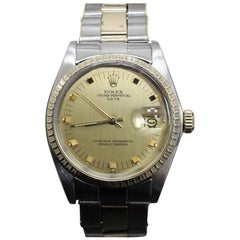 Rolex Date 1505 Collectible 14 Karat Gold and Stainless Steel Engine Turn Bezel