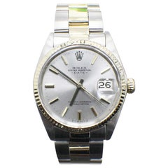Rolex Date 1500 18 Karat Yellow Gold and Stainless Steel Silver Dial