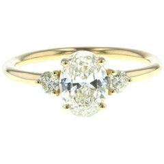 Three-Stone Oval Diamond Engagement Ring with Round Side Diamonds 'GIA'