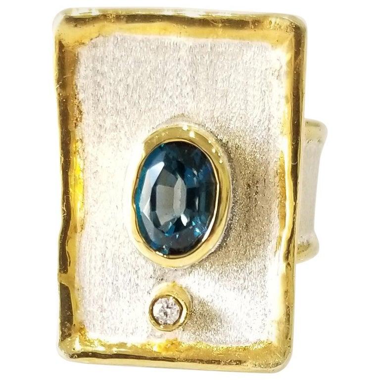 Yianni Creations 1.25 Carat Blue Topaz Diamond Fine Silver 24 Karat Gold Ring For Sale