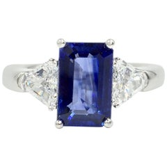 3.13 Carat Blue Sapphire Platinum Ring with Trillion Diamonds