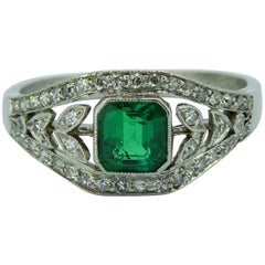 Art Deco 0.50 Carat Emerald Diamond Ring, circa 1930s, Floral Diamond Surround