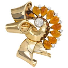 Retro Gold, Cabochon Citrine, and Diamond Stylized Bow Brooch