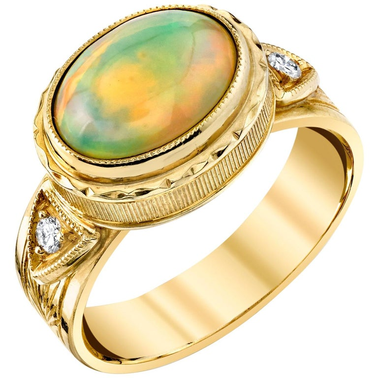 1.44 Carat Opal with 0.08 Carat Diamonds 18 Karat Yellow Gold Ring