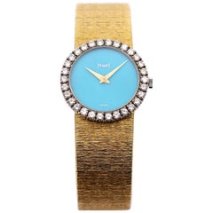 Gold Piaget Wristwatch with Turquoise Dial and Diamond Bezel