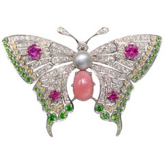 Conch Pearl, Demantoid Garnet, Ruby and Diamond 18 Karat Butterfly Brooch