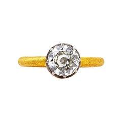 24 Karat Gold Ring with an Old European Mine Cut Diamond