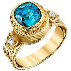 4.87 Carat Blue Zircon with 0.11 Carat Diamonds 18 Karat Yellow Gold Ring