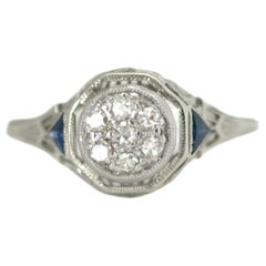 1920s Art Deco Diamond, Blue Sapphire and 18 Karat White Gold Filigree Ring