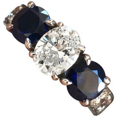1.65 CTW Oval Diamond and Blue Sapphire Three Stone Engagement Ring - Ben Dannie