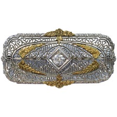 Antique Art Deco Diamond Filigree Platinum and 14k Gold Brooch, 0.15 Carat