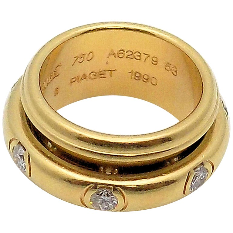 18 Karat Yellow Gold Diamond Band by Piaget, Possession Rolling Style Ring For Sale