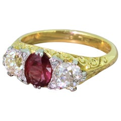 Early 20th Century Ruby and Old Cut Diamond 18 Karat Gold Trilogy Ring