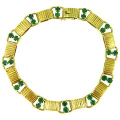 1960s Boucheron Paris Emeralds Yellow Gold Link Bracelet