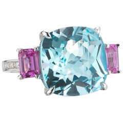 18 Karat White Gold Blue Topaz, 12.10 Carat and Pink Sapphire, 1.20 Carat Ring