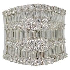 3.31 Carat Round Brilliant and Baguette White Diamond Ring in 18 Karat Gold