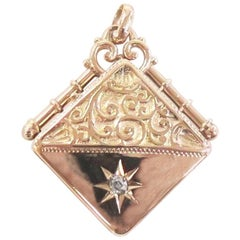 Victorian 14 Karat Rose Gold Repousse Locket with Old Mine Cut Diamond