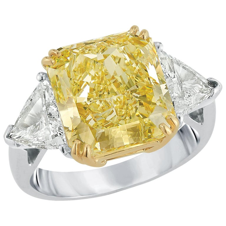 Magnificent Fancy Yellow 7.49 Carat Cushion Cut Diamond Engagement Ring