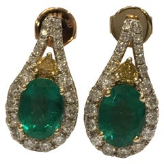 Emerald Yellow and White Diamonds Earrings Set in 14 Karat Yellow Gold