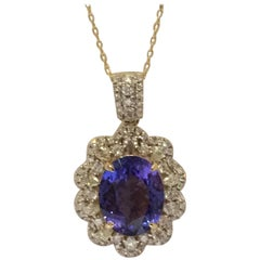 Tanzanite and Diamonds Set in 14 Karat Gold Pendant with Yellow Gold chain