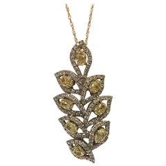 Yellow and White Diamond Pendant Set in 18 Karat White Gold