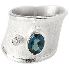 Yianni Creations 1.10 Carat Blue Topaz and Diamond Fine Silver Palladium Ring