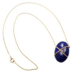 Tiffany & Co. Large Lapis Lazuli Crossover Oval Yellow Gold Pendant Necklace