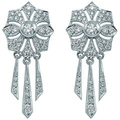18 Karat White Gold Solitaire Diamond Flower Dangle Earrings