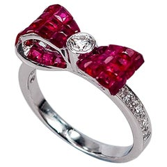 18 Karat White Gold Ribbon Invisible Ruby Ring